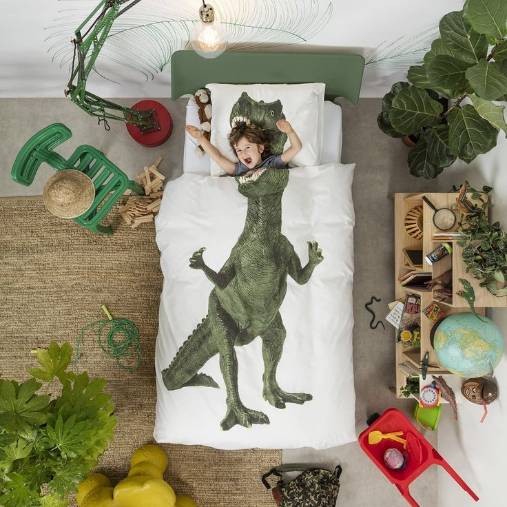 Do-you-think-he-snore-us? A favourite for all little monsters, these prehistoric creatures can now feature at the centre of your little one's bedroom. The photographic SNURK Dinosaur Single Duvet Set will coax any resistant sleeper into bed at night. Do you dare to fall asleep between his razor-sharp teeth? Of course you do! Bring the world of extinct adventure back to life with this luxury kids bedding. He will become your child's enormous Jurassic pal! (like Pete's Dragon?)Features and…