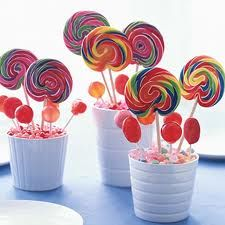 lolly pop and candy centerpieces... a pleasantly unusual twist