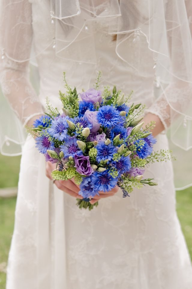 this bouquet contains blue cornflowers, white astrantia, purple lisianthus flowers and buds  and foliage known as 'bells'  flowers named by Mary Woodbridge