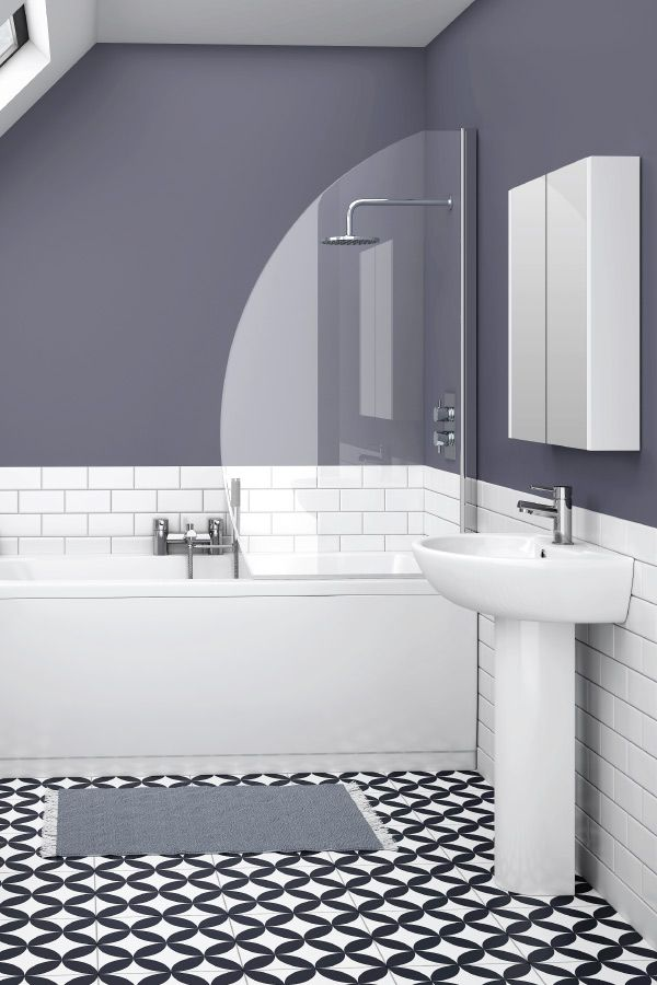 This stylish small bathroom design includes a short projection basin, mirrored wall cabinet and compact shower bath.