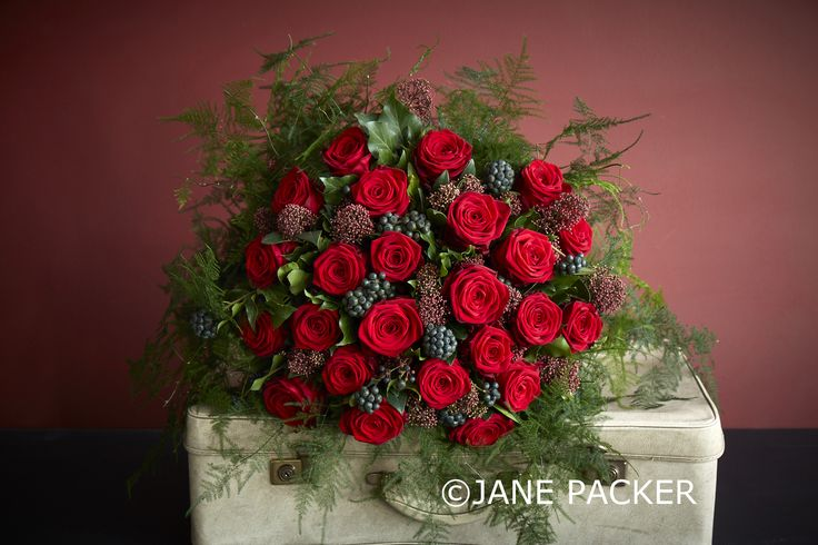 Our showstopping twenty four red Rose bouquet is back. This year with a rich variety of foliage, beautiful Berried Ivy, a scattering of splendid Skimmia and a plethora of Fern foliage.