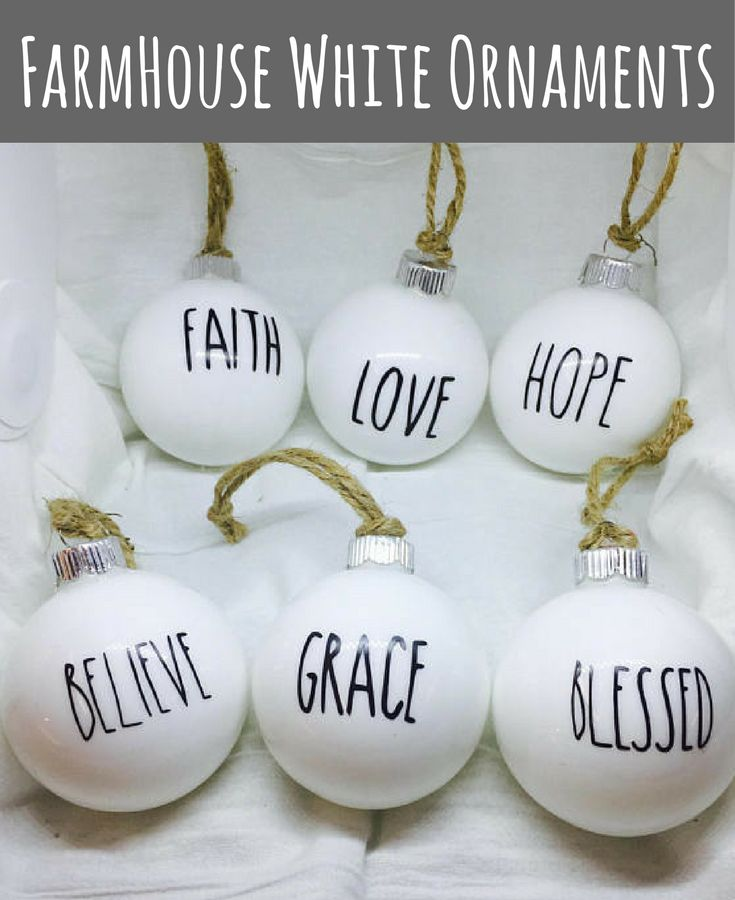 Simple, Rae Dunn inspired white glass ornaments with burlap ribbon add rustic charm to traditional holiday decor. Rustic Farmhouse Christmas ornaments, farmhouse white Christmas ornaments, farmhouse Christmas tree ornaments Decor, Rustic Christmas Décor, Christmas Ornaments #ad #affiliatelink