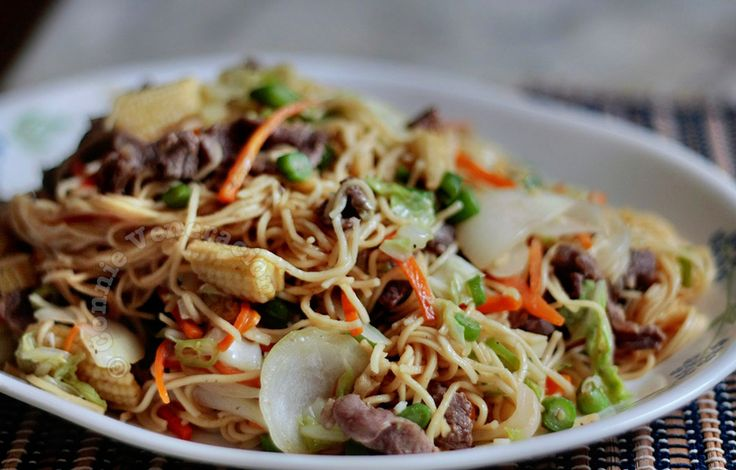 The Vietnamese peanut sauce that goes with spring rolls was the basis for the flavors of this sweet and tangy Oriental noodles with peanut sauce.