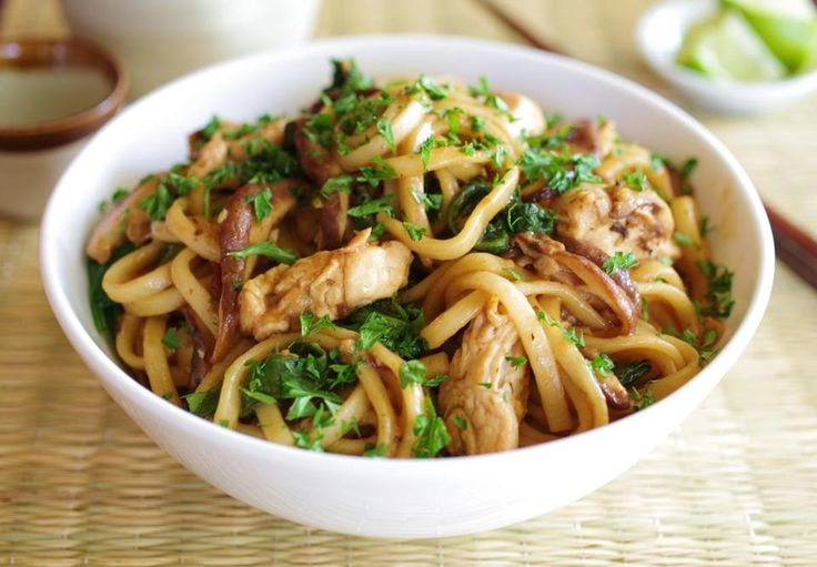 08sunday - Molly Kravitz' recipe for udon noodles with chicken, mushrooms, and spinach. (Karoline Boehm Goodnick)