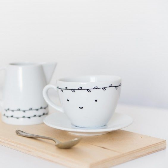 smiling  with white leaves | coffee cup