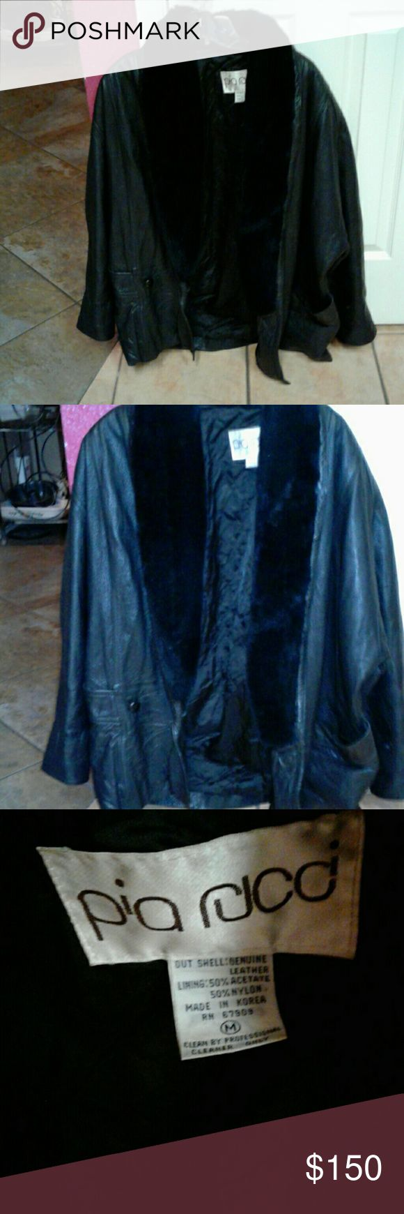"""Leather Jacket!  """"M"""" Pus Rjco, heavy! Beautiful M Black Leather Jacket, 2 deep front pockets, button closure, faux fur around neck and front sides only, lining is quilted.  Interesting design with Dolman sleeves, adjustable sleeve llengths, a simple single cuff can be made 2 fit shorter arms.  It's very, very warm, gifted 2 me by Veterinarian friend who used it once in Alaska while he was chosen 2 attend to annual huge dog sled race dogs.  In Austin, we do NOT ever need such heavy jackets…"""