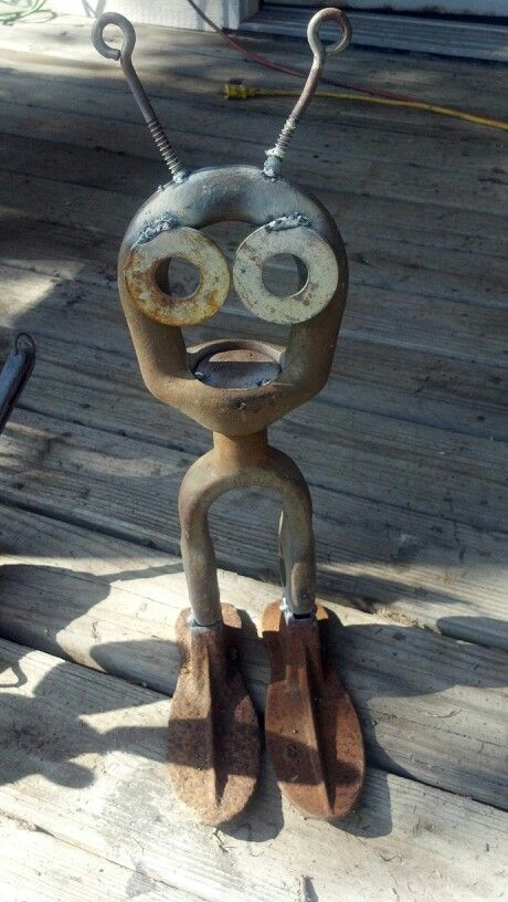 """""""I come in peace.""""  Alien made from recycled metal.   (artist not listed)"""