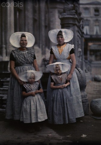 Two women pose with their daughters all in Zeeland folk costume. 1931