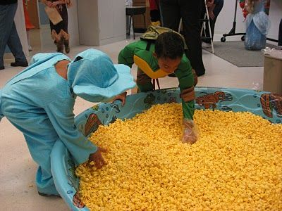 Fill a swimming pool with popcorn and and thrown in the gold wrapped chocolate and let the kids search for the gold. This would be a hit!
