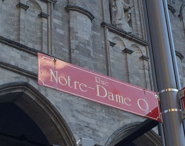 Rue Notre-Dame street sign outside the Basilique Notre-Dame de Montréal in Old Montréal. #montreal #quebec #canada #travel #architecture #notredame