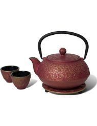 Miya Scarlet Blossom 34-Ounce Cast Iron Teapot and Teacup Set w/ Strainer and Trivet, Pink. This set includes cast iron teapot with strainer, 2 cups and a trivet. Not recommended for stove top use. Packaged in a black gift box. Made in China 34 oz. teapot Hand wash recommended No microwave Great as favors or part of a Japanese themed gift.