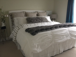 Pottery Barn: flax shams, ruffle duvet, wesley throw Target: branch flannel sheets