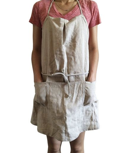 Keep splatters of cranberry sauce off of your holiday outfit with this adjustable apron. Five front pockets ensure there's plenty of room for all of the kitchen tools—thermometer, spatula, and more—a huge feast requires. Available in black, white, and natural beige.