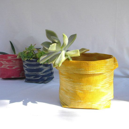 Ikat fabric containers - by 7100 Islands  Each piece is made in their workshop in France using authentic ikat made from the natural fibers of abaca, hand-woven on backstrap looms by tribespeople of the Philippines.