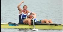 316a: This positive image conveys the joy felt by British competitors Glover and Stanning as they claim Great Brittian's first gold of the games. The two exhibit a relaxed body language which contributes to the effect of the image. The background is neutral causing these two to stand out in their yellow boat in the center of the frame.