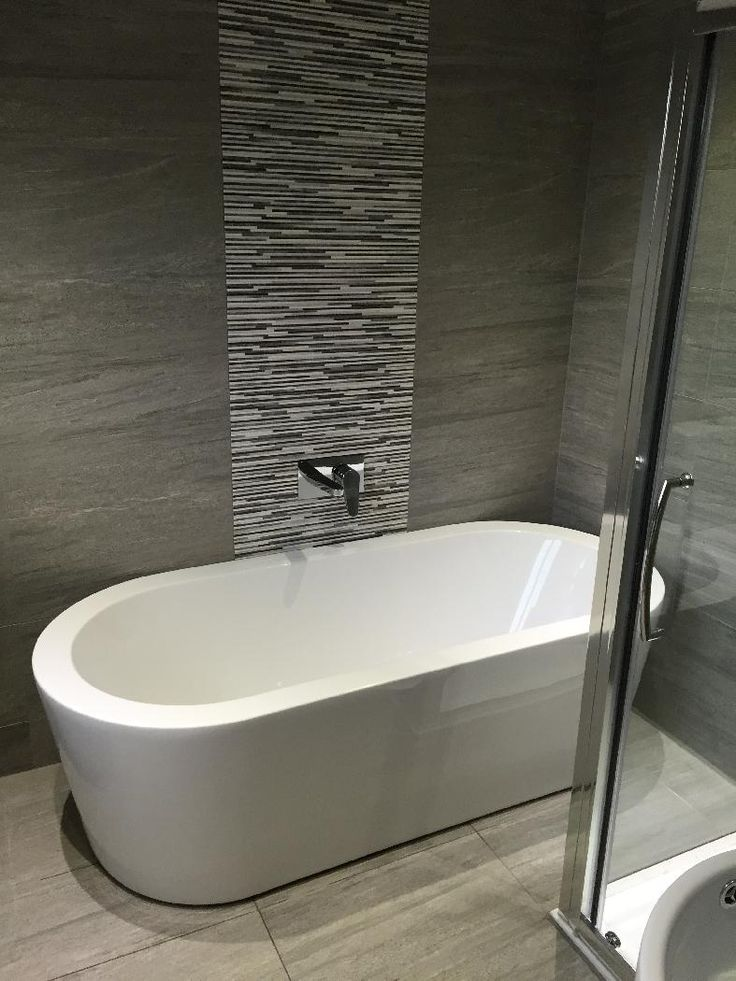 The Arc freestanding bath looks beautiful against the grey tiles in this bathroom belonging to Jason in Newcastle Upon Tyne #VPShareYourStyle