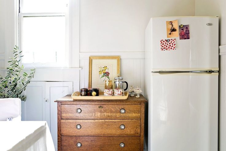 Anna's Inspiring & Inviting Flat. Love the use of furniture like dressers as extra counter space in the kitchen!