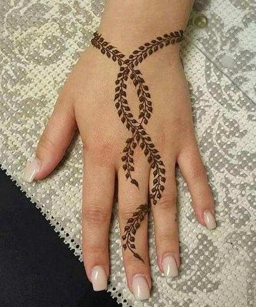 Cute Back Hand Henna Tattoo Designs