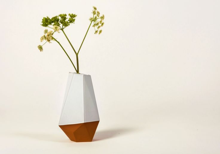 Unique, faceted terracotta vase for a striking centrepiece. Available in unglazed or half-glazed in white.