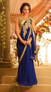 Amazingly crafted chiffon and faux georgette indowestern saree style gown. The saree style gown in blue cooler is done with the rich work of gold zardosi, resham, sequins and stone.This readymade gown has maximum bust size of 40 inches..