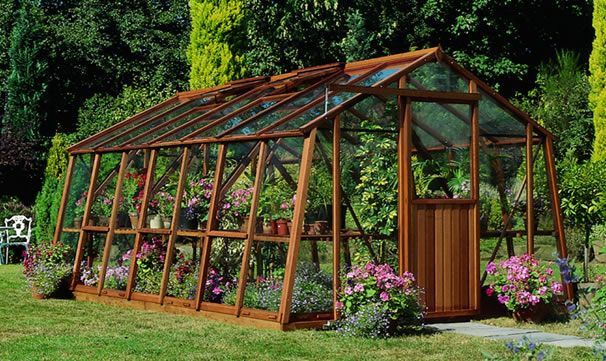 Glass green house construct a greenhouse in your garden for Garden greenhouse designs