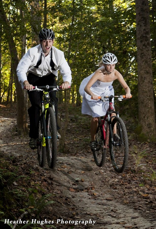 Super fun Williamsburg engagement portrait on mountain bikes complete with wedding dress and tux. by Heather Hughes Photography