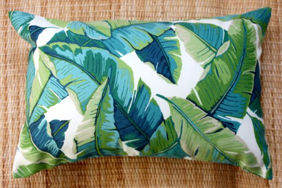New addition to my outdoor line of cushions , classic banana leaf in cool teals and blues. The fabric is 100% spun polyester which gives over 500 hours of sunlight. I still advise keeping out of the weather when not in use to prolong the life of your cushion. This listing is for the cover only and design features on both sides. It is smartly finished with an invisible zip and is machine washable. Eco inserts are available, please message re cost. Check out my complete online store…
