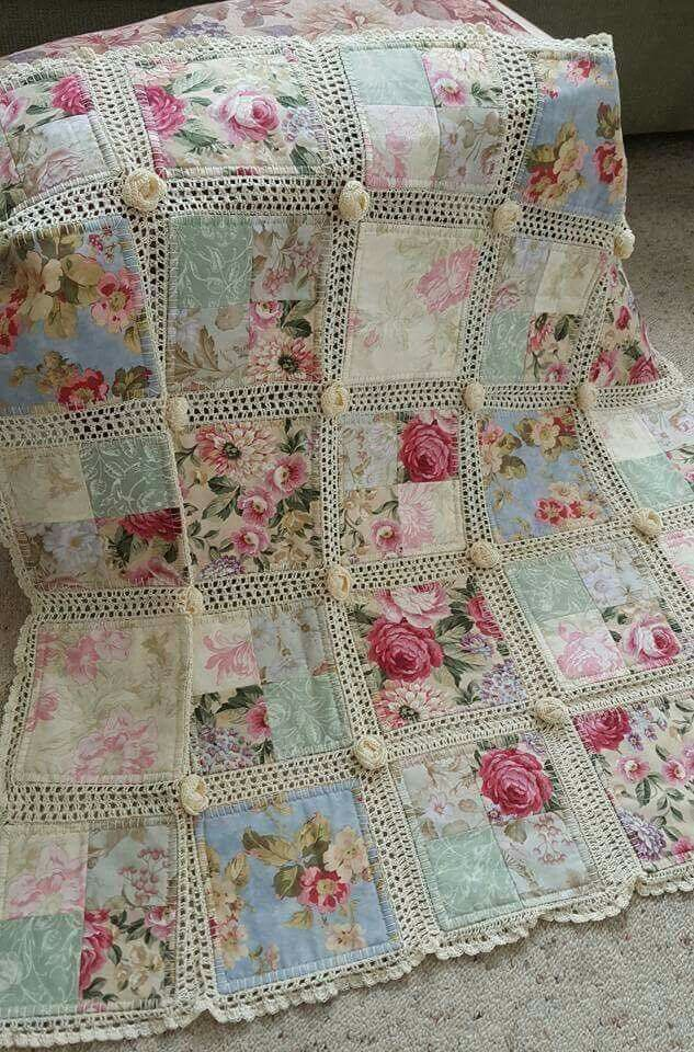 Gorgeous quilt with blanket stitch edges on the blocks and then crocheted together with rosettes in the corners.