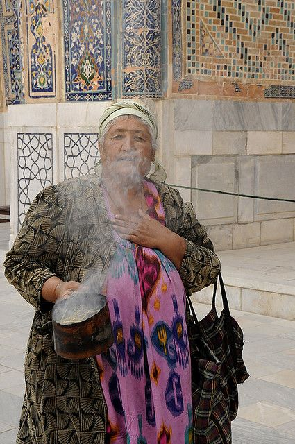 Samarkand, Uzbekistan. This burning plant ( sage) is believed to keep away bad spirits. Women often going shop to shop and ask money to clean the place from bad spirits this way