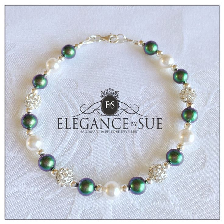 A personal favourite from my Etsy shop https://www.etsy.com/uk/listing/530606269/dark-green-white-pearl-bracelet