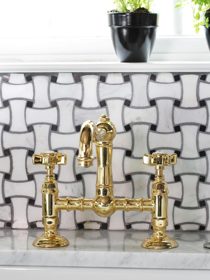 To complement the farmhouse style of the apron sink, a polished brass faucet was chosen for its classic lines and sharp contrast against the white porcelain and white Carrera marble countertops. Faucets affect the fabrication of solid-surface countertops. When sourcing a faucet, find out if the chosen fixture is a single-, double- or triple-hole. Then relay this information to the fabricator, who will center the holes on your chosen apron sink.