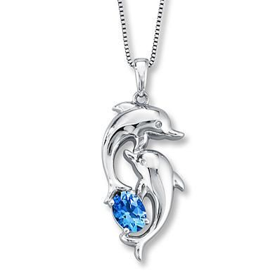 The beautiful blue topaz accent makes this dolphin pendant adorably gorgeous.