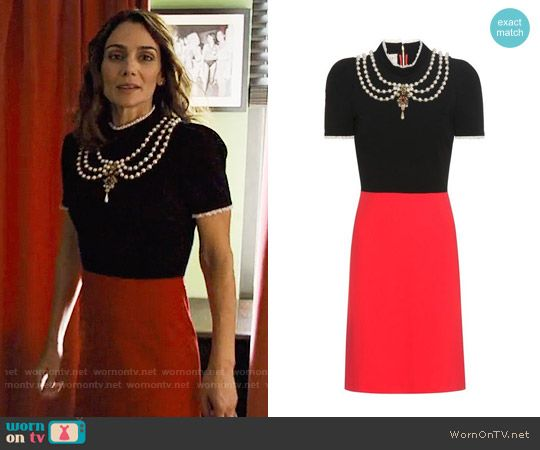 Sam's black and red dress with pearls on Friends from College.  Outfit Details: https://wornontv.net/75727/ #FriendsfromCollege