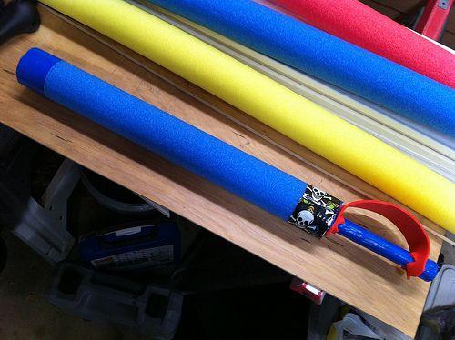 DIY Foam Sword:  A pool noodle, 1/2 inch PVC pipe, craft foam & some tape.