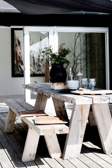 outside dining room with rustic wooden furniture