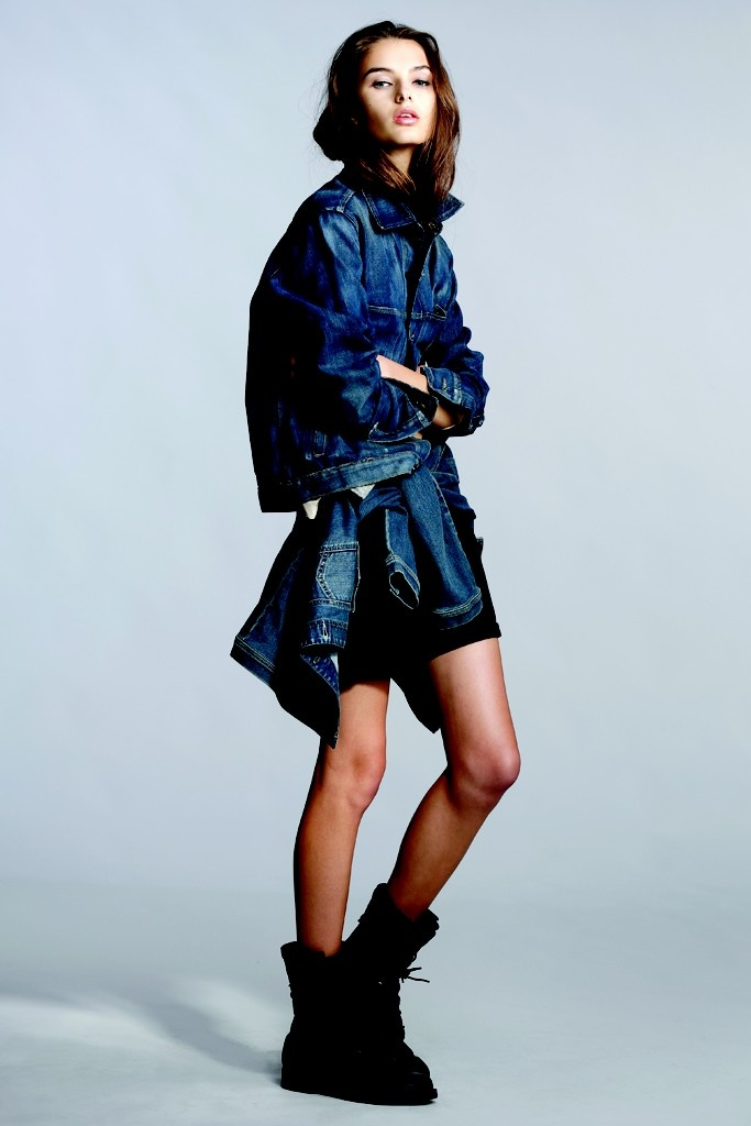 Denim Trend: Girl Likes Boy (Thvm's cotton jacket; Not Your Daughter's Jeans' silk blouse and cotton denim jacket, tied at waist; Cheap Monday's cotton denim shorts; Vintage boots.)