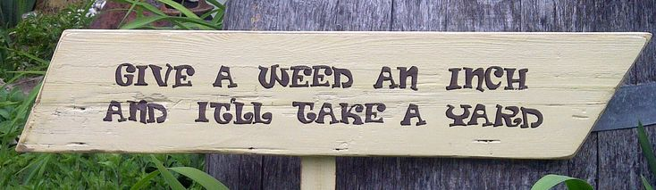 Garden Sign Handpainted Reclaimed Wood  'Give A Weed An Inch And It'll Take A Yard'. $25.00, via Etsy.