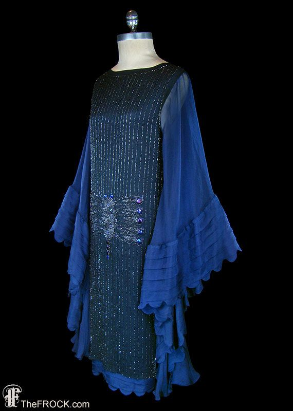 1920s glass dragonfly beaded and jeweled silk flapper dress with knife-pleated wing sleeves and scalloped hem.