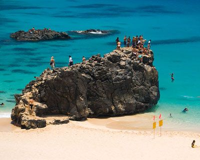 Jumping off the rock at Waimea Bay, and trying to swim with the crazy waves there. #Aqua12staysofchristmas