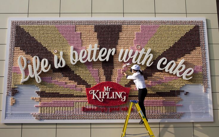 Mr Kipling erects a poster made out of over 13,000 cakes