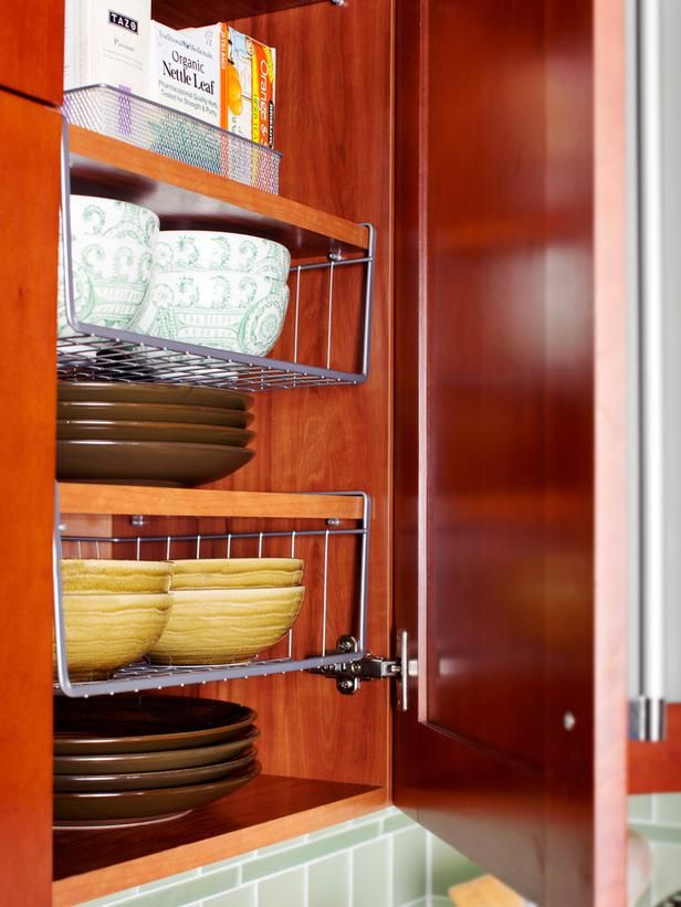 Space-Saving Ideas for Making Room in the Kitchen: Shelving space inside Sarah and John's wall-mounted cabinets is maximized with stackable wire racks. The racks come in different heights and widths, and they allow various sizes of plates to be stacked neatly within the same cabinet. From DIYnetwork.com