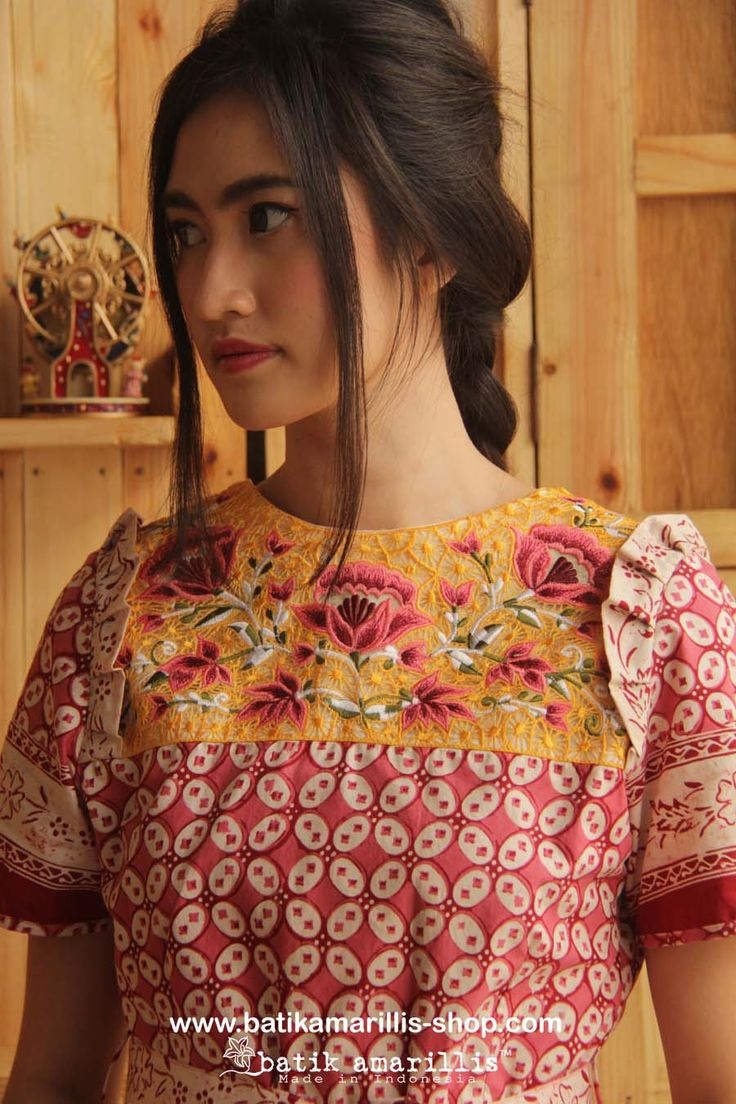 www.batikamarillis-shop.com Batik Amarillis's Innocencia dress ......with ruffled at chest, softly pleated skirt, it is truly a sweetheart dress.. Made of pink batik kawung Banyumas & Tasikmalaya krancang embroidery -Indonesia