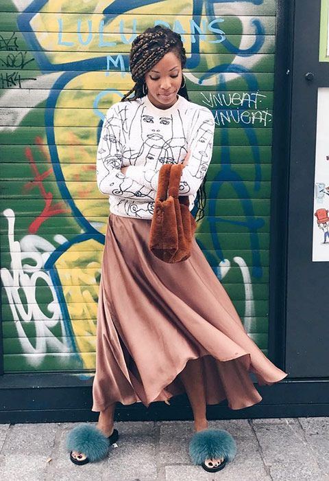 A sporty graphic sweat grounds a satin dusky rose skirt and fluffy accessories (sliders plus a mini-tote) add some fun texture.