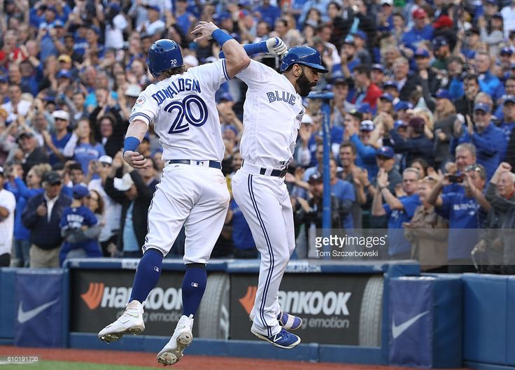 Jose Bautista #19 of the Toronto Blue Jays celebrates his three-run home run with Josh Donaldson #20 in the eighth inning during MLB game action against the New York Yankees on September 24, 2016 at Rogers Centre in Toronto, Ontario, Canada.