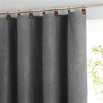Looking at this makes me think that wool blankets from an army surplus store would make really nice curtains, pillow covers or tablecloths etc;  Wool Curtain with Leather Tabs from La Redoute