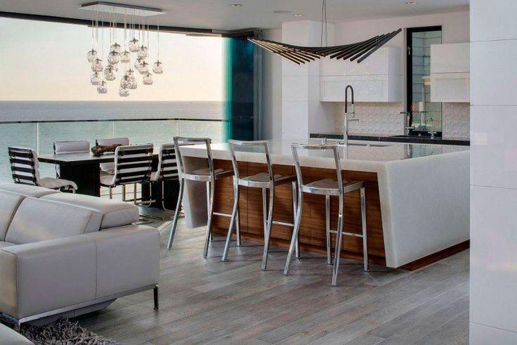 conception cuisine contemporaine - îlot central fonctionnel, chaises de bar métalliques, hotte décorative et suspension boules