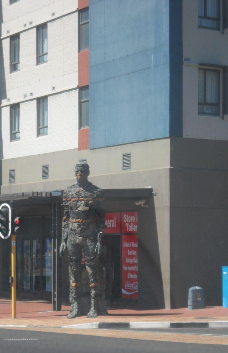Angus Taylor's giant stone(d) man on street corner....surprise!
