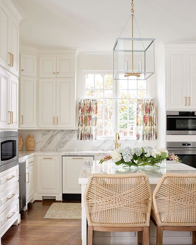 white kitchen design by blue print interiors | dallas interior designers | woven barstools | marble countertops and backsplash | blue print | blueprintstore.com