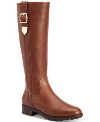 Easton is a refined, knee-high leather boot with statement belting and an edgy flash of shine. A lightly padded footbed, treaded outsoles and a full side zipper make this clean-lined pair easy to pull