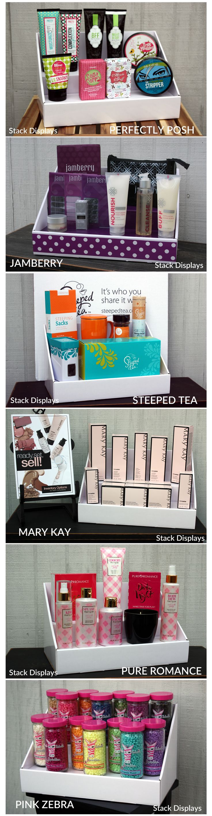 White Cardboard Counter Displays from Stack Displays. Shown here with products from different Direct Sales Companies. Perfectly Posh, Jamberry Nails, Steeped Tea, Mary Kay, Pure Romance and Pink Zebra Home.These displays are a crisp white color and come with a unique laminated finish. Many different color and design options to choose from. Use at vendor events, craft shows, home parties or festivals when displaying your products.